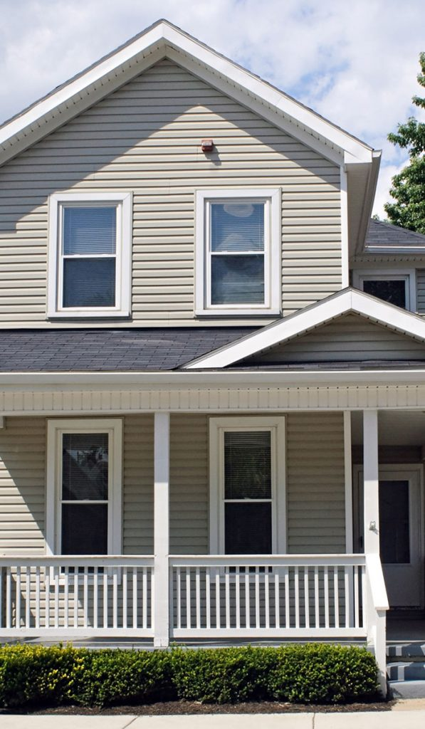 Urbandale Two-Story Residential House with white siding and a dark grey roof