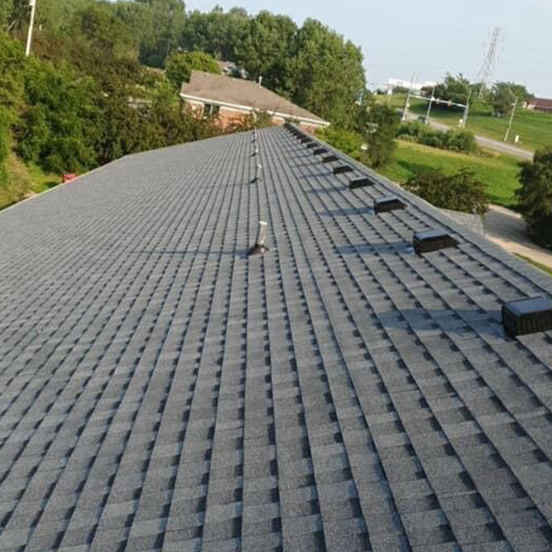 Aerial shot of a grey commercial shingle roof