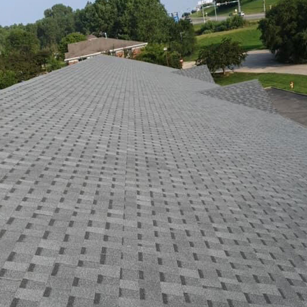 Aerial shot of a new grey shingle roof in Urbandale, IA