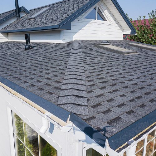 Close-up of a grey shingle flat roof on a house in Iowa